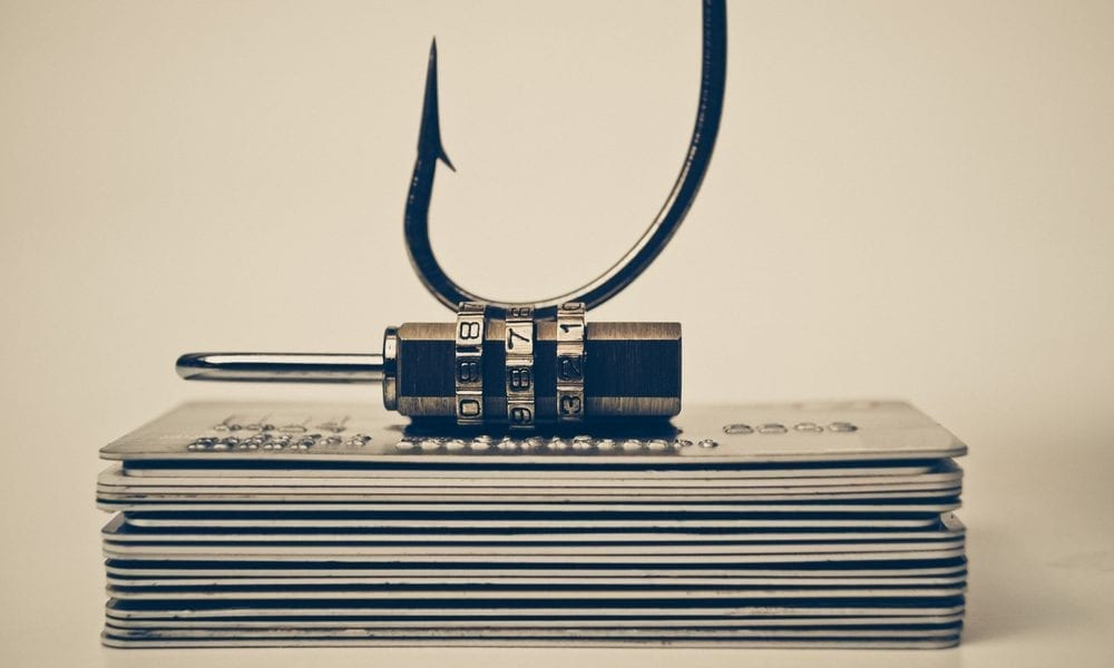 Image of a fishing hook on a lock covering a stack of papers